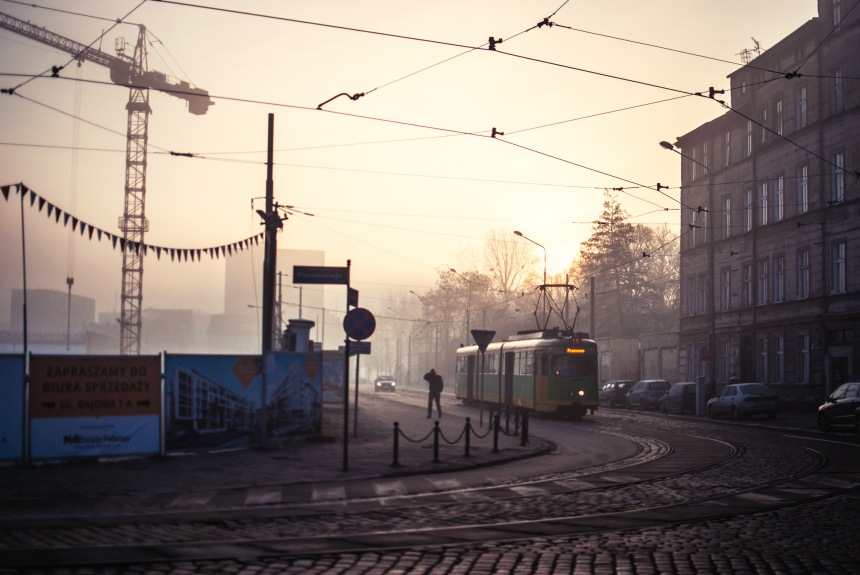 foggy morning tram stop man walking construction site jezyce