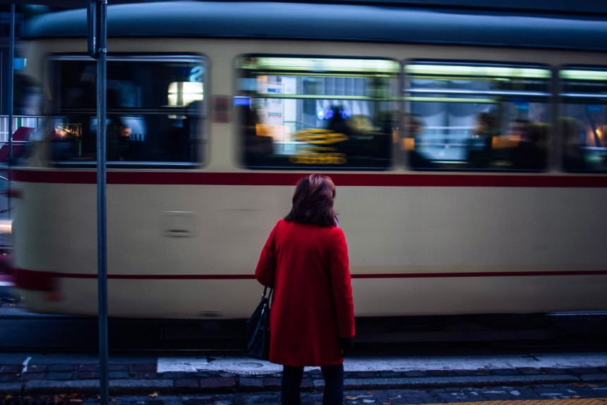 lady-red-coat-and-tram-speeding-by-small