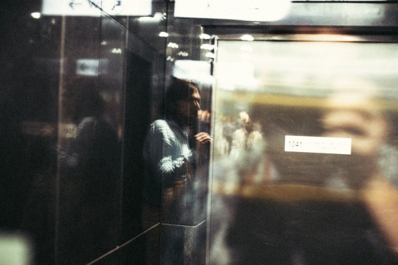 man-in-elevator-blurred-abstract-small