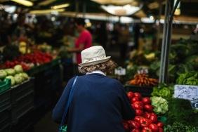 older woman picking veggies