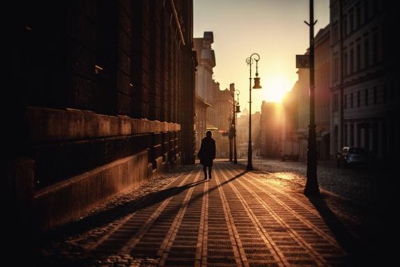 stary rynek bright sun early morning woman walking