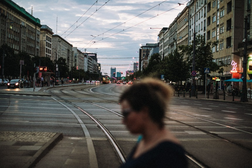 street-long-sunset-woman-crossing-in-front-small