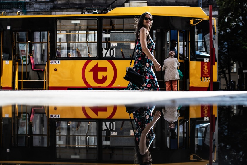 Tram-and-woman-refelction-small