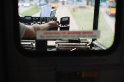 tram-driver-cabin-hand-showing-small