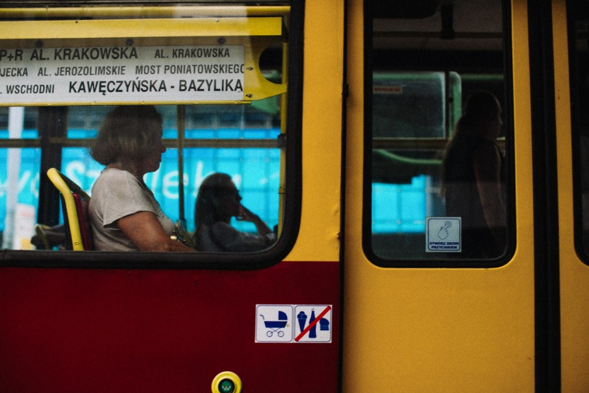 tram-side-blue-and-red-and-yellow-woman-in-window-small