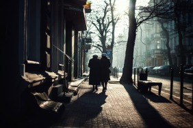 two-ladies-walking-into-sunny-sidewalk-jezyce-church-sunday-morning-winter-SMALL