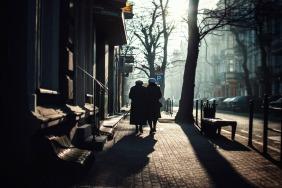 two-ladies-walking-into-sunny-sidewalk-jezyce-church-sunday-morning-winter-SMALL