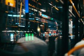 reflection-of-window-inside-tram-man-standing-night-warsaw-small