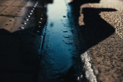 world-on-a-wire-shadows-puddle-steet-small