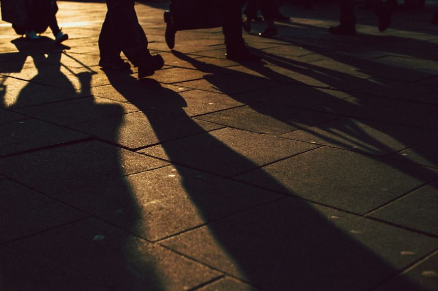 long-shadows-of-people-walking-back-lit-legs-and-feet-small