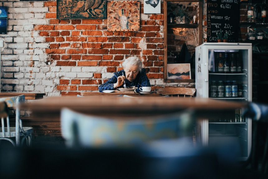 older lady eating breakfast