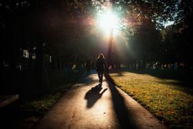 sunrise-stary-browar-man-walking-path-into-sun-bright-small