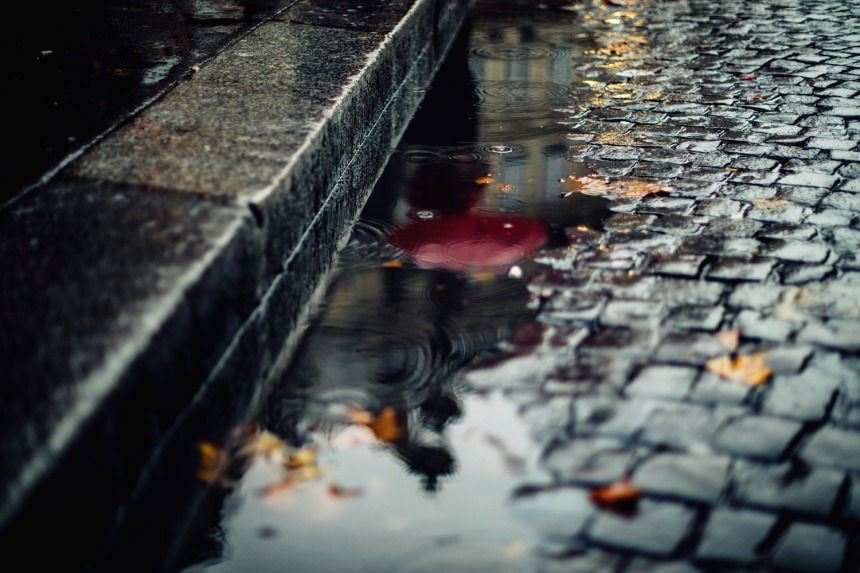 red-umbrella-in-reflection-raining-paris-small