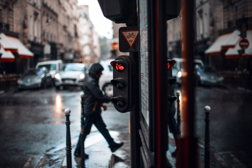 wet-rainy-day-paris-red-stop-sign-man-crossing-street-small